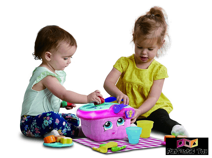 two girls playing with shapes and sharing picnic basket