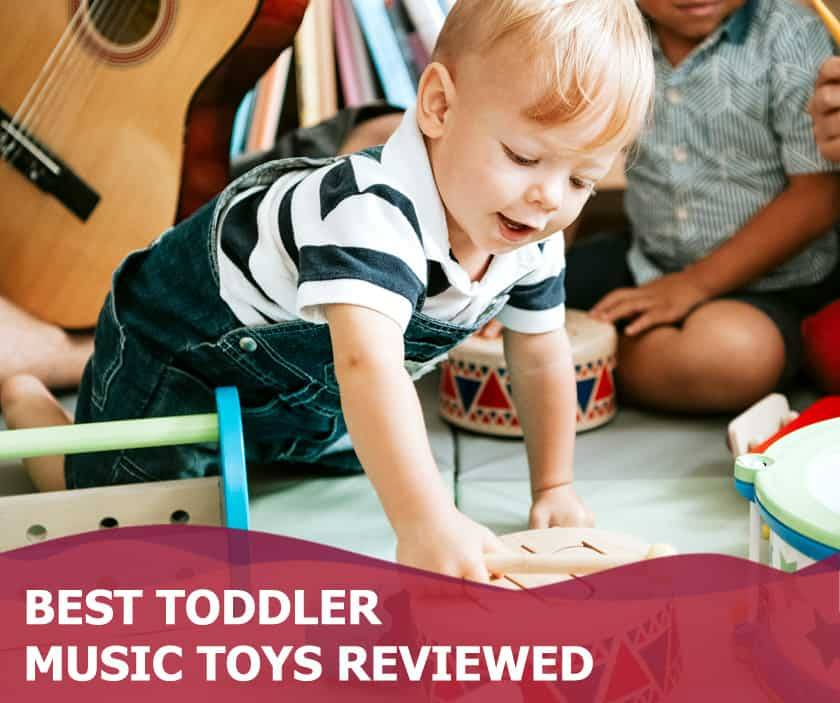 Featured image of cute toddler boy playing with wooden drum set