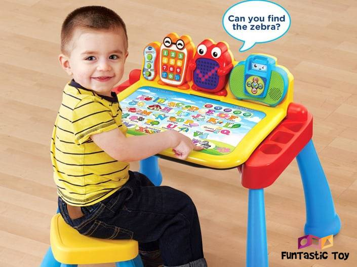 Image of boy playing with VTech Touch and Learn Activity Desk Deluxe Interactive Learning System