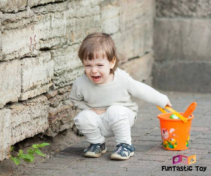 Image of child crying on the street
