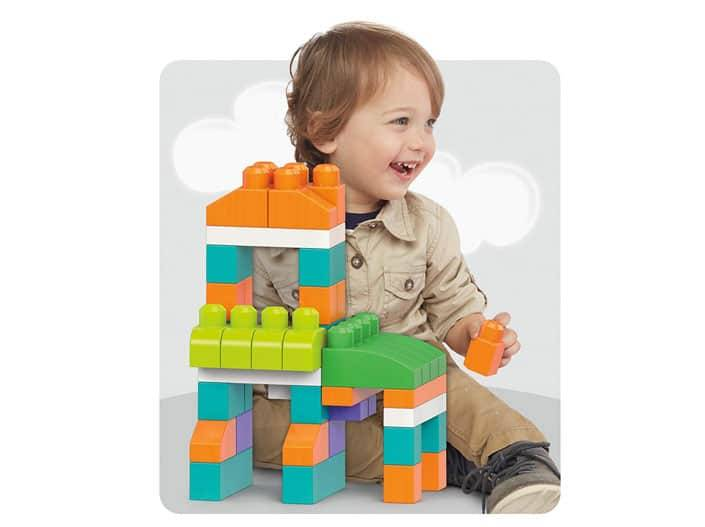 Image of happy boy playing with Fisher-Price Mega Bloks review