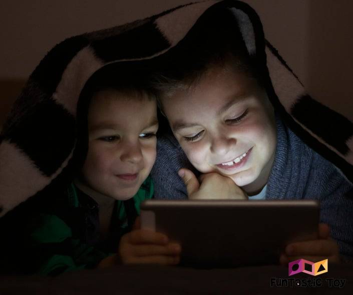 Image of two kids watching movie