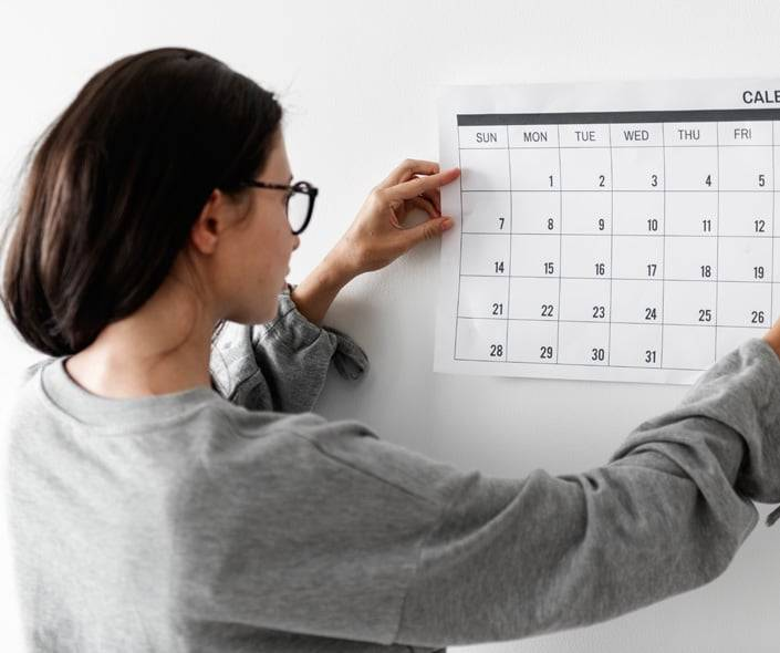 Image of woman checking calendar