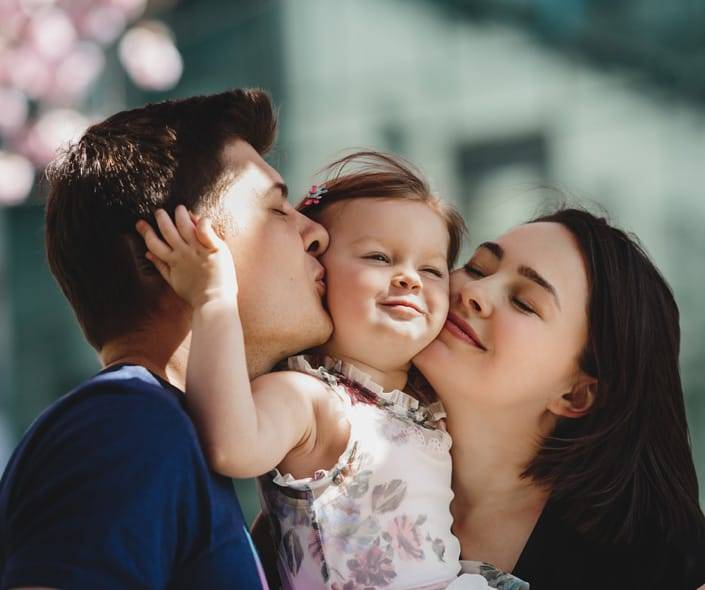 Image of young parents with little daughter