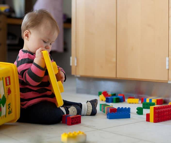 Featured image of baby playing with legos on floor