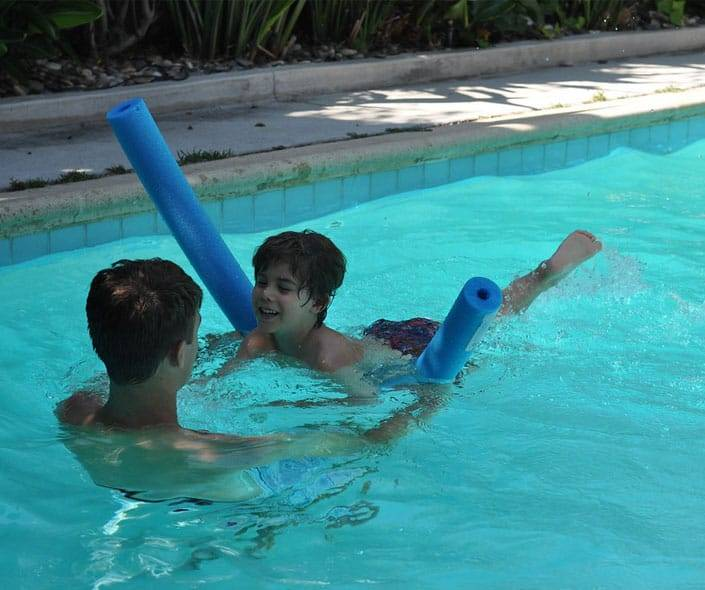 Featured image of father teaching son swimming