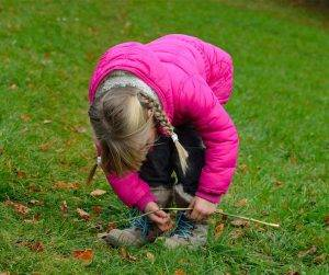 Featured image of little girl in pink jacket tying shoelaces