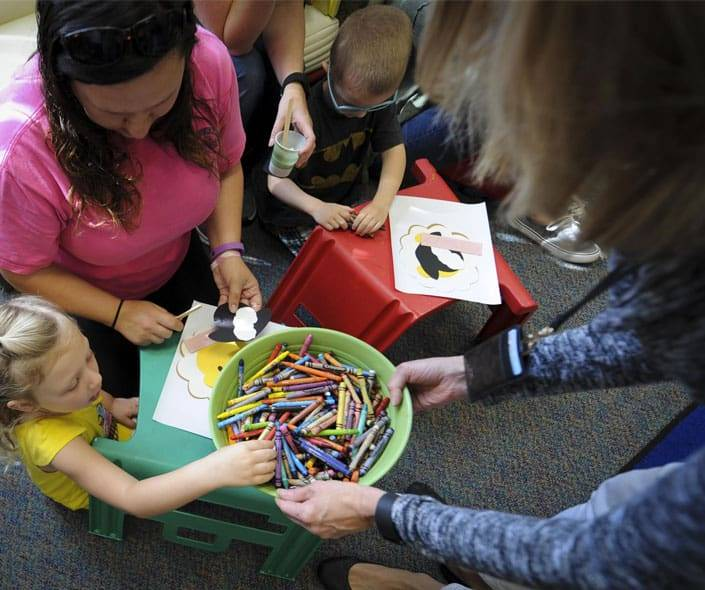 Featured image of little girl taking crayons to draw