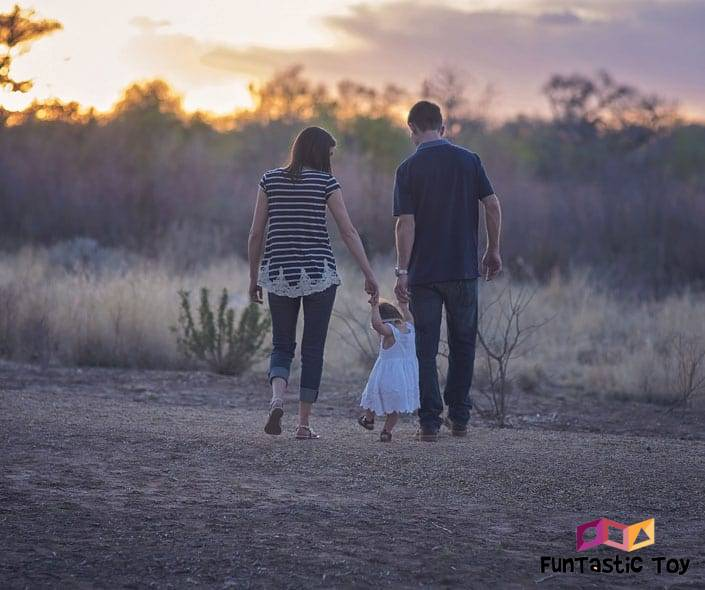 Image of couple walking baby daughter