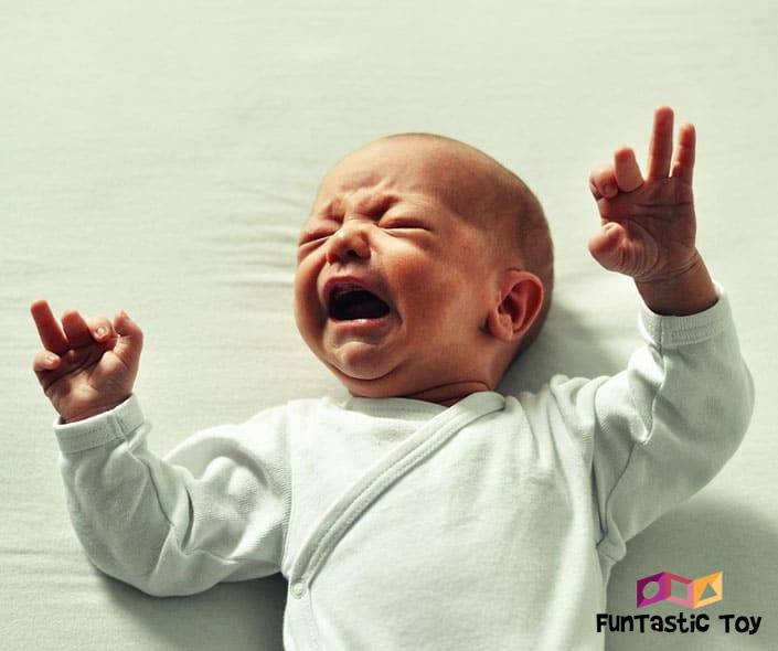 Image of crying baby on bed
