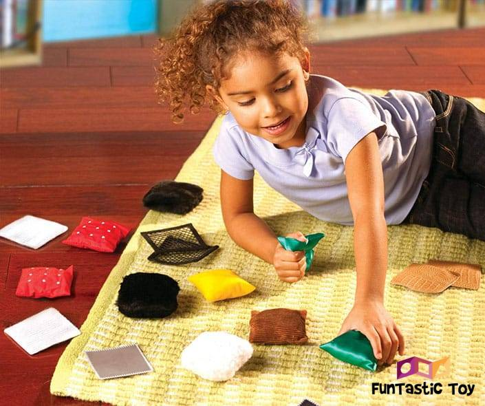 Image of girl playing with tiny cushions