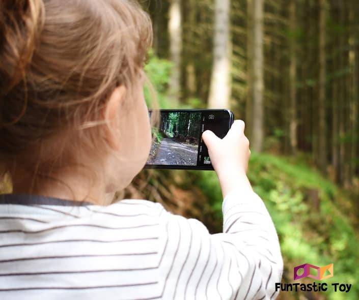 Image of girl with smartphone in the woods