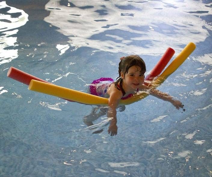 Image of little girl learning to swim