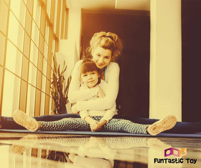 Image of mother hugging daughter stretching