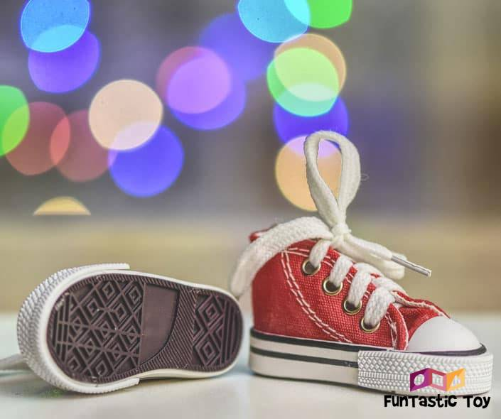 Image of red baby shoes with shoelaces