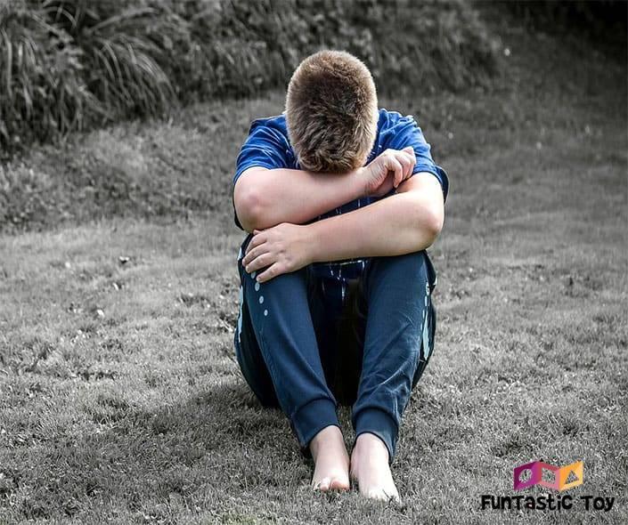 Image of sad boy in blue