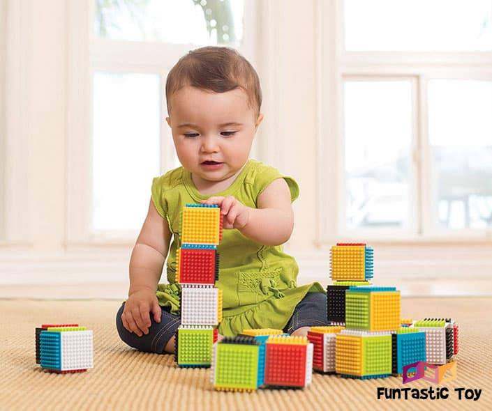 Image of toddler playing with sensory blocks