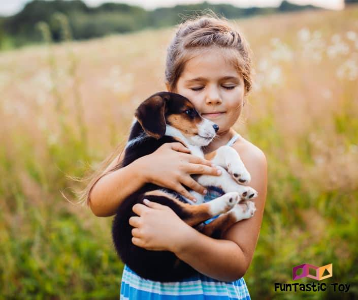 Featured image of girl holding cute puppy outdoors