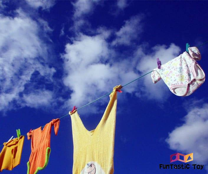 Image of baby clothes drying with blue sky