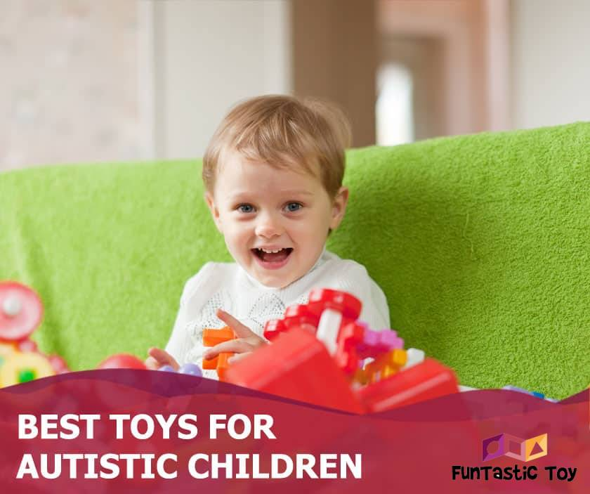 Featured image of excited little boy playing with blocks