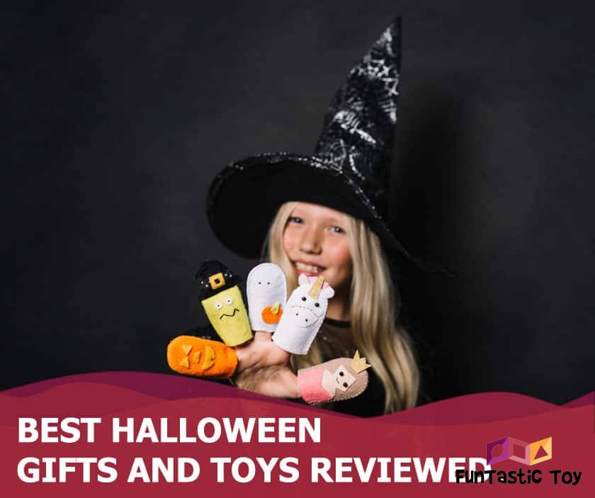 Featured image of blonde girl in witch costume holding halloween toys