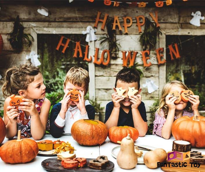 Featured image of four children at table on halloween