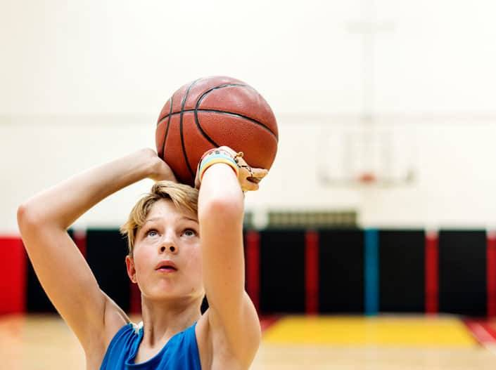 Featured image of kid playing basketball