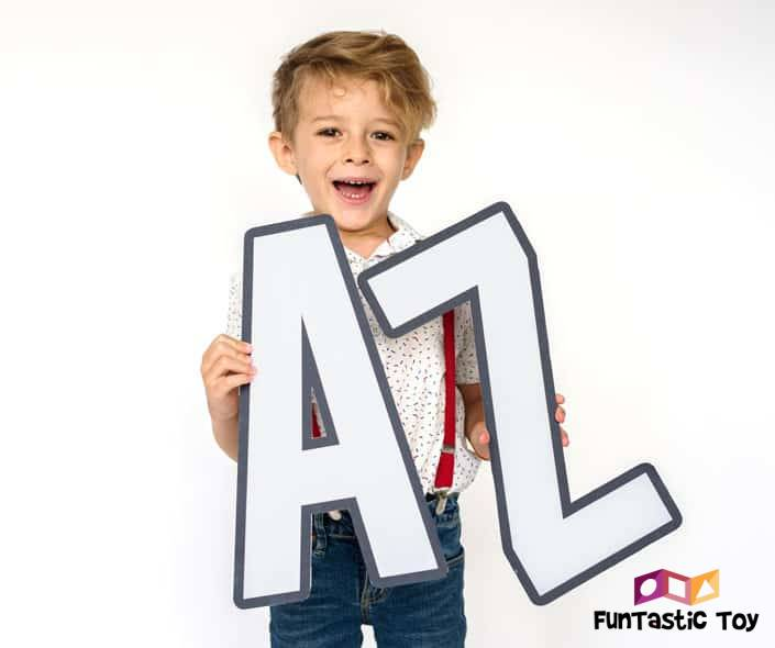 Featured image of smiling boy holding white AZ letters