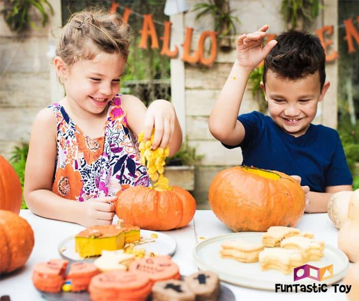 Featured image of two children at table with food playing with pumpkins