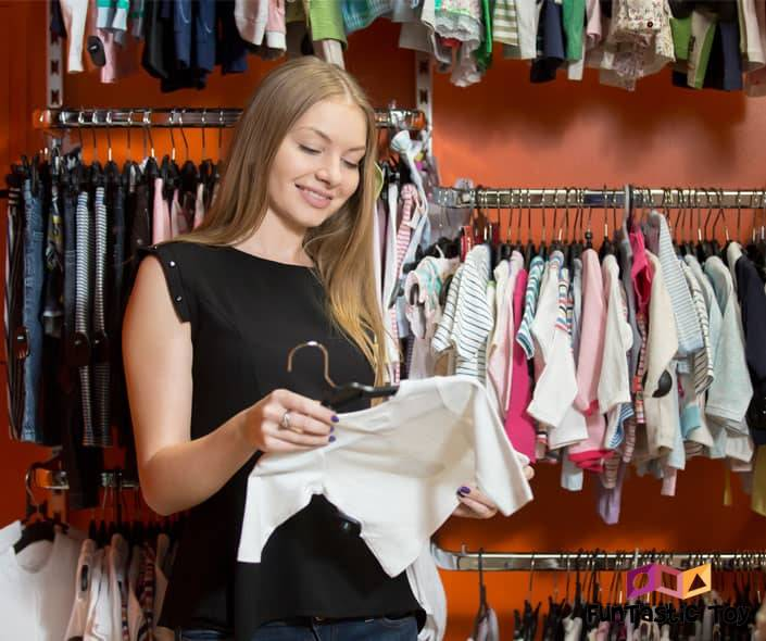 Featured image of woman shopping for baby clothes