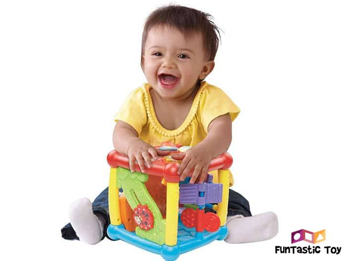 Image of baby playing with cube