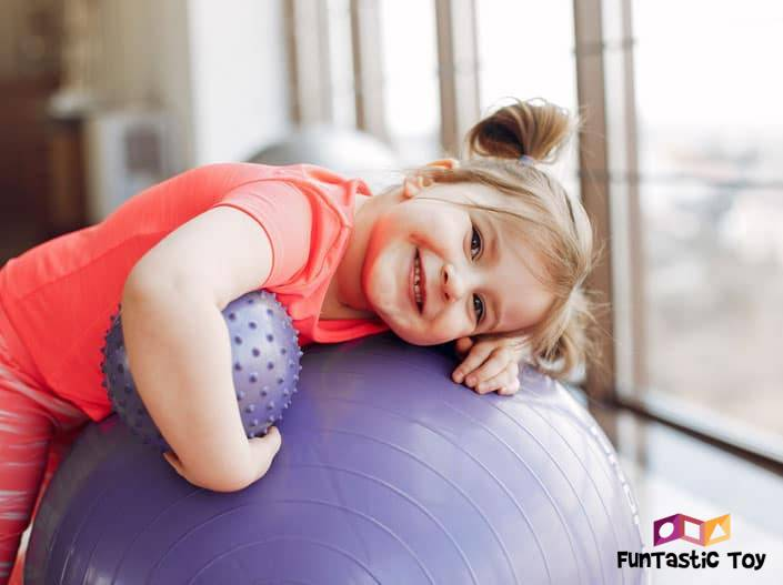 Image of cute girl with purple ball