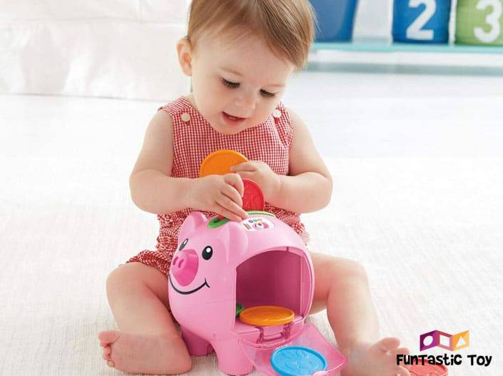 Image of girl in the dress playing with Piggy Bank