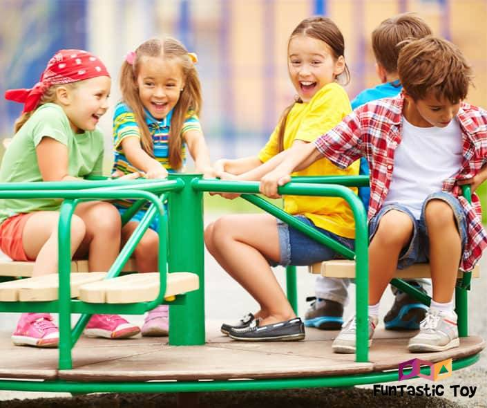 Image of happy children sitting on carousel