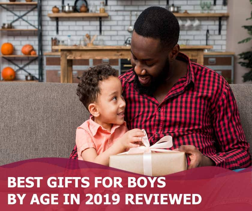 Featured image of black father giving gift to son on couch