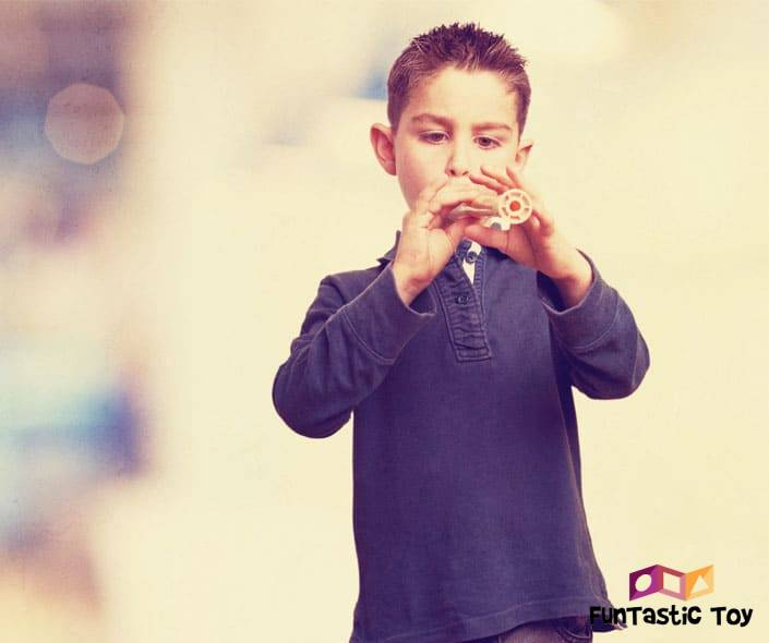 Image of boy in blue playing flute