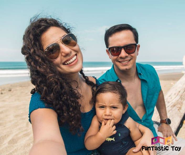 Image of family with baby on beach