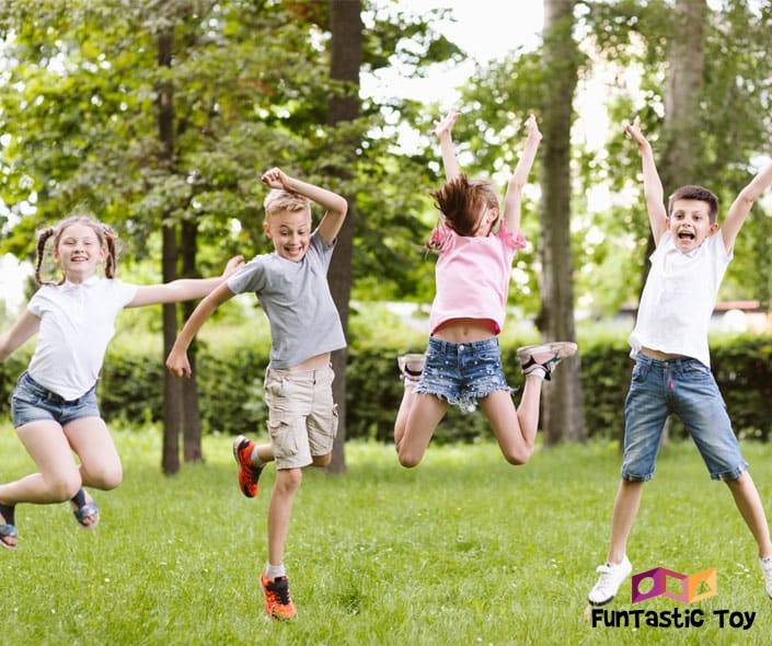 Image of happy kids jumping in park