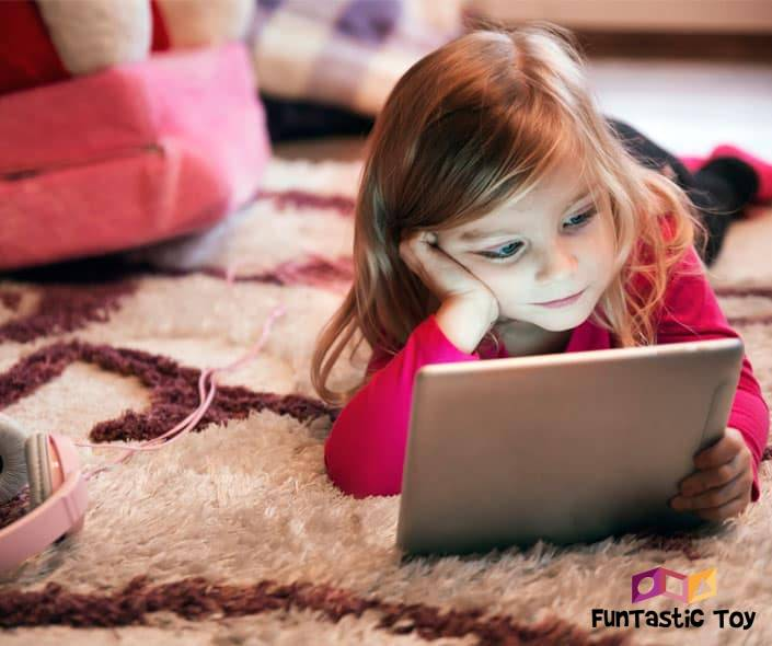 Image of little girl on floor looking at tablet