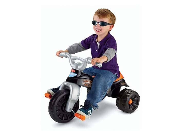 Image of smiling boy riding Fisher Price Harley Davidson Trike