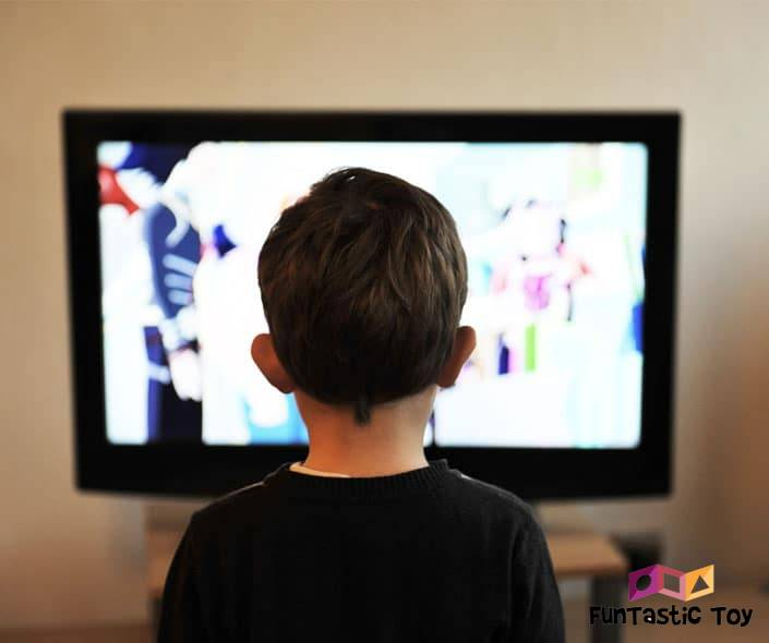 Image of boy from the back watching cartoon on tv