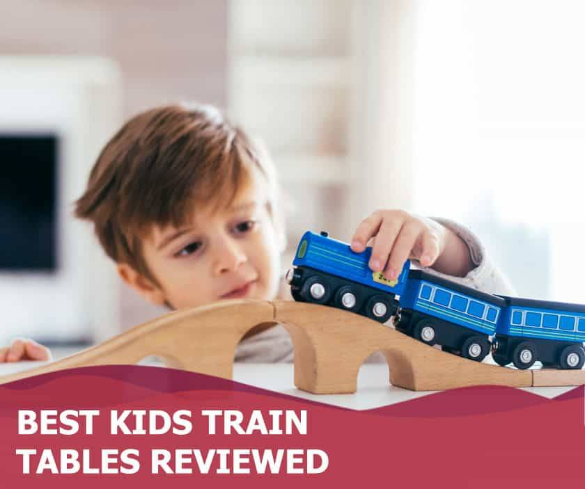 Featured image of adorable boy playing with train toy on table